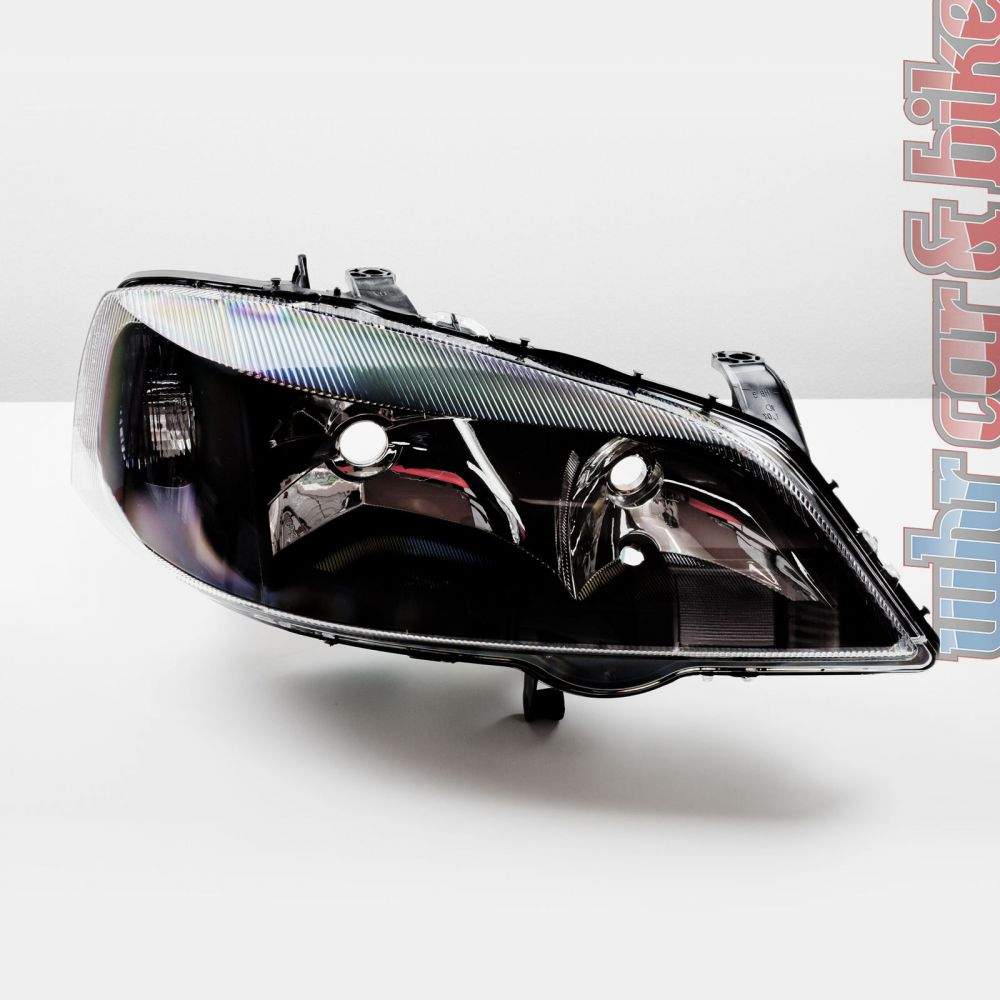 hella magic color klarglas scheinwerfer schwarz opel astra. Black Bedroom Furniture Sets. Home Design Ideas